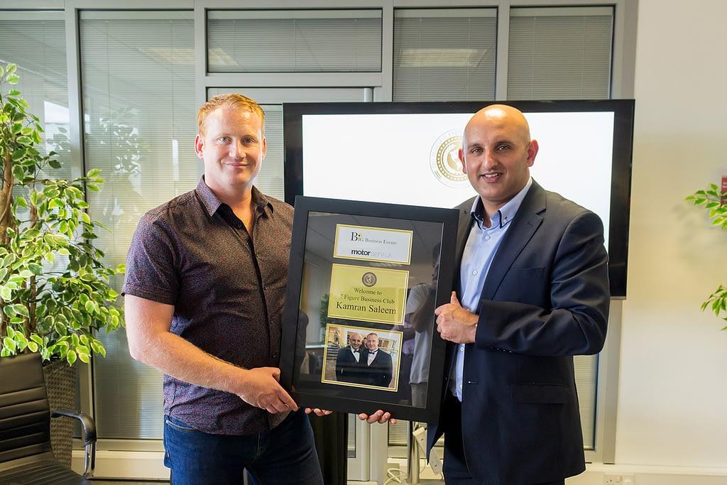Adam Stott helps automotive boss Kamran Saleem