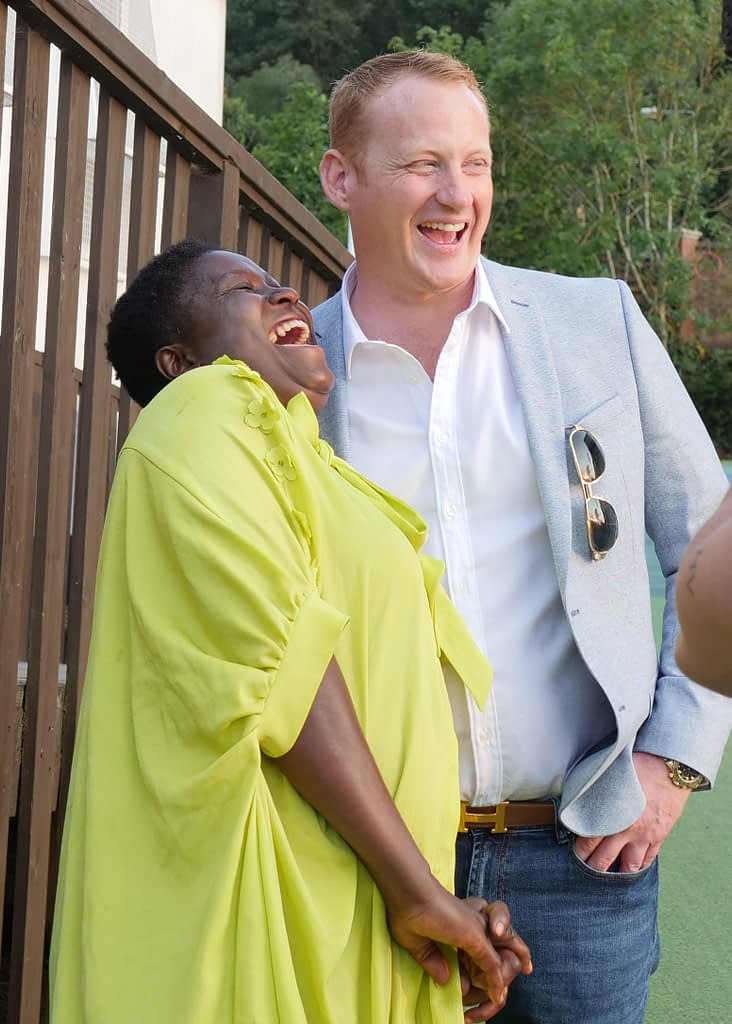 Adam and Kiptieu share a laugh whilst filming for Rich House Poor House